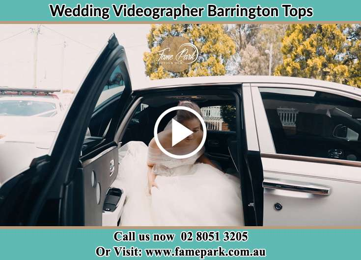 The Bride going out the bridal car Barrington Tops NSW 2422