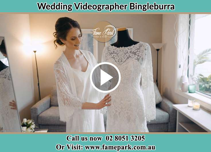 The Bride looking at her wedding gown Bingleburra NSW 2311