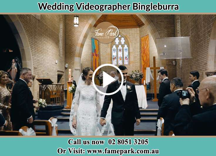 The Groom and the Bride walking out the church Bingleburra NSW 2311