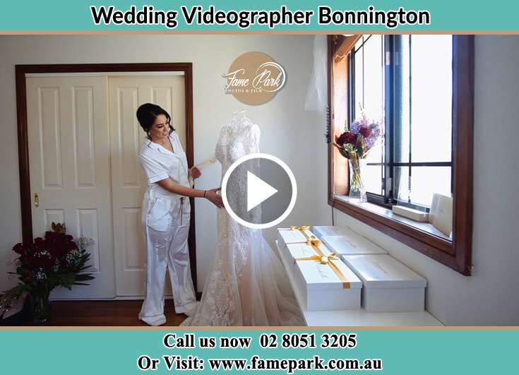 The Bride looking at her wedding gown Bonnington NSW 2587