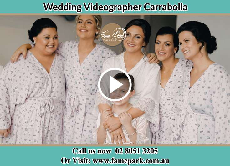 The Bride posing for the camera together with her relatives Carrabolla NSW 2311