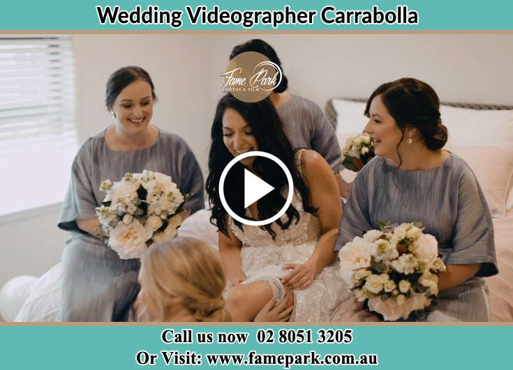 The Bride holding a bouquet of flowers with her family Carrabolla NSW 2311