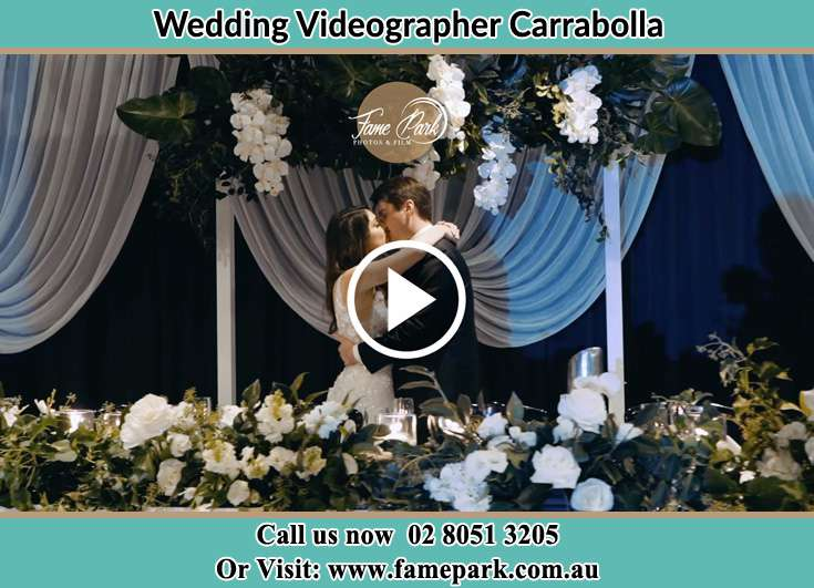 The newlyweds kissing Carrabolla NSW 2311