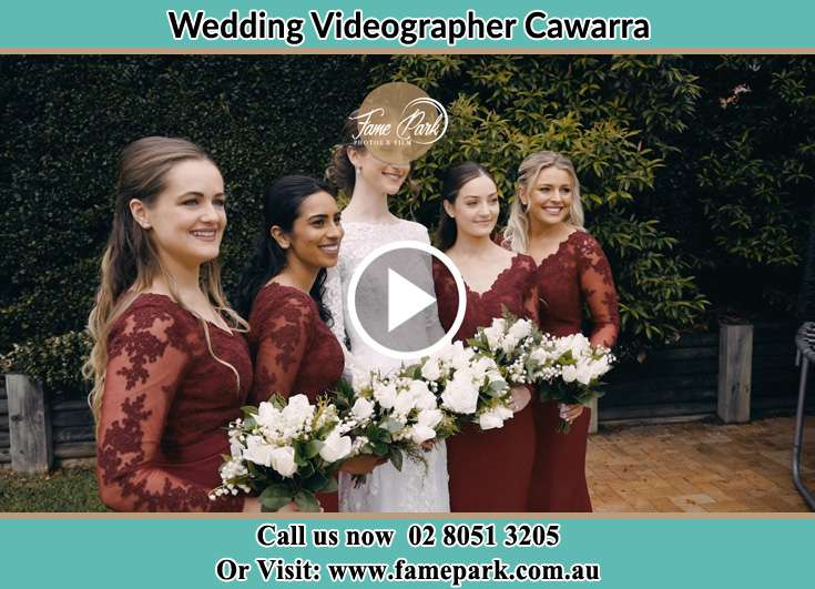 The Bride posing for the camera with her bridesmaids Cawarra NSW 2229