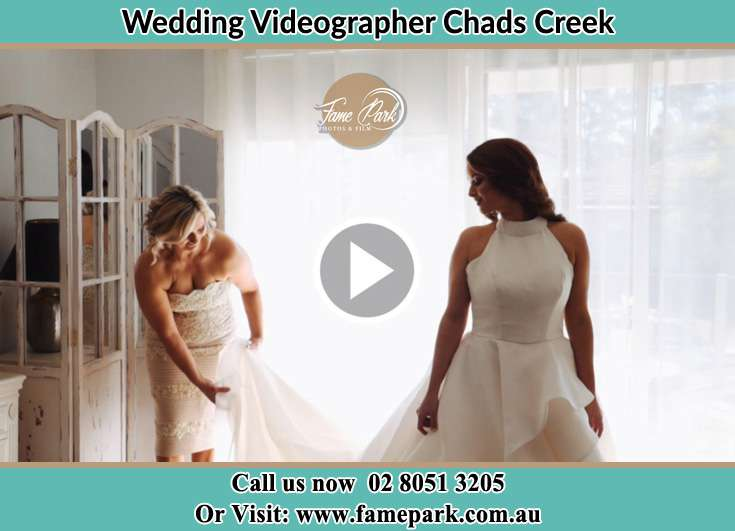 The Bride Assisting by her friend with her wedding gown Chads Creek NSW 2311