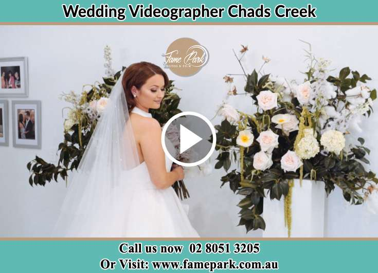 The Bride holding a bouquet of flowers Chads Creek NSW 2311