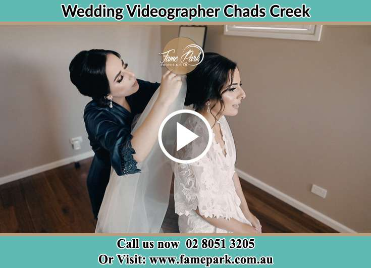 The bride assisting by her mother with her veils Chads Creek NSW 2311