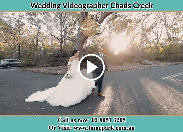 The Groom and the Bride walking in the park Chads Creek NSW 2311