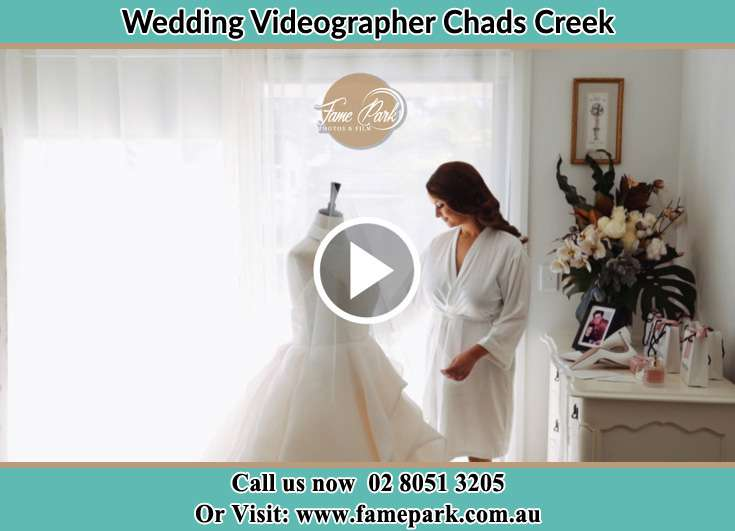 The Bride looking at her wedding gown Chads Creek NSW 2311
