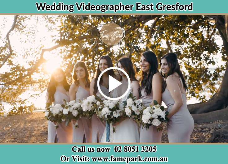 The Bride posing for the camera with her bridesmaids East Gresford NSW 2311