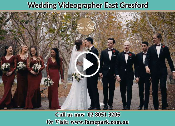 The Groom and the Bride kissed in the park while their bridesmaid and bestmans looks East Gresford NSW 2311