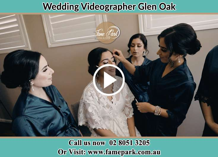 Applying make up to the bride Glen Oak NSW 2320