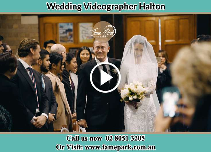 The Bride walking down the aisle with her father Halton NSW 2311