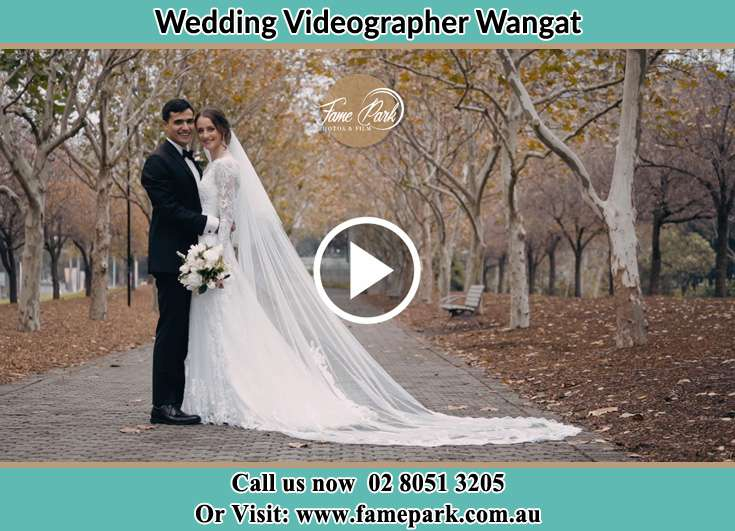 The Bride and the Groom posing for the camera at the park Wangat NSW 2420