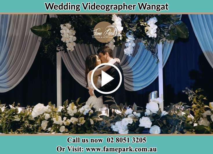 The newlyweds kissing Wangat NSW 2420